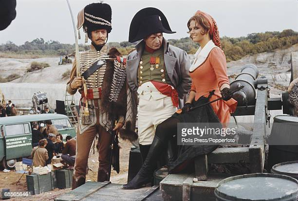 From left, English actor Peter McEnery, American actor Eli Wallach and Italian actress Claudia Cardinale, all dressed in character as Colonel Gerard,...