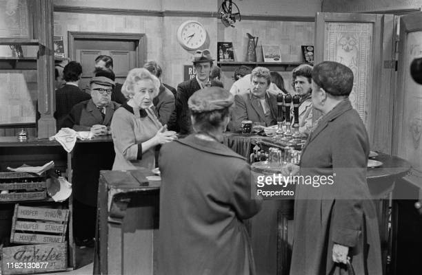 From left English actors Jack Howarth as 'Albert Tatlock' Doris Speed as 'Annie Walker' Peter Adamson as 'Len Fairclough' and Pat Phoenix as Elsie...
