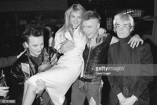 From left English pop singer Boy George American socialite Cornelia Guest English singer Marilyn and American pop artist Andy Warhhol May 1985