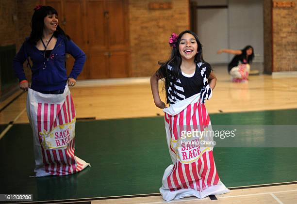 From left Esmeralda Amaya Stephany Zambrano and Brenda Padilla are in the sack race of Skinner Community Night at Skinner Middle School on Thursday...