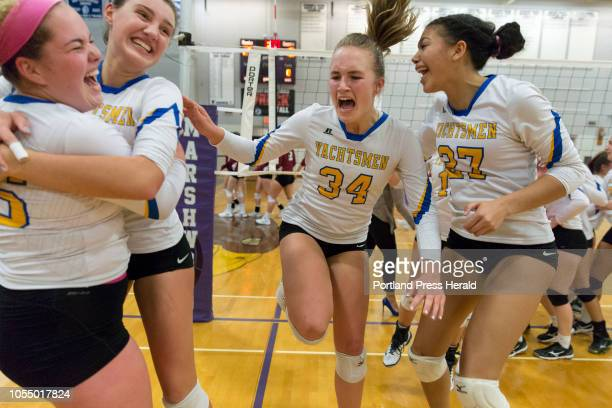 From left Falmouth players Summer Spiegel Annika Hester Katie Phillips and Rose Riversmith celebrate their Class A volleyball state championship win...