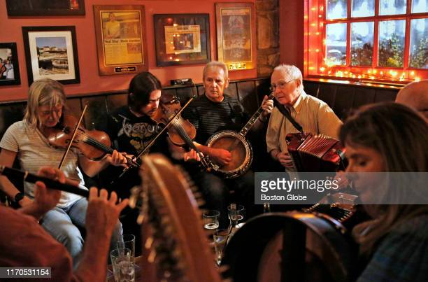 From left Fiddler Alexandra Galperin plays beside fiddler Sean Connor banjo player Terry O'Shea and accordion player Tommy Sheridan during an Irish...