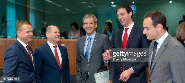 Finnish Finance Minister Petteri Orpo is talking with the German Federal Minister of Finance Olaf Scholz the Austrian Finance Minister Hartwig Loeger...