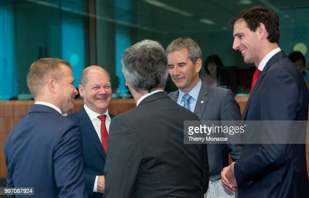 Finnish Finance Minister Petteri Orpo is talking with the German Federal Minister of Finance Olaf Scholz the Portuguese Finance Minister President of...