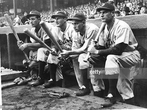 First baseman Hank Greenberg , outfielder Goose Goslin , second baseman Charlie Gehringer , and rightfielder Pete Fox of the Detroit Tigers hold...