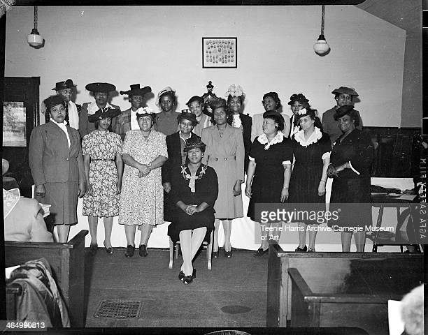 Members of the Woman's Missionary Society of the AME Church posed in front of altar in Speer Street AME Church Belle Vernon Pennsylvania April May...