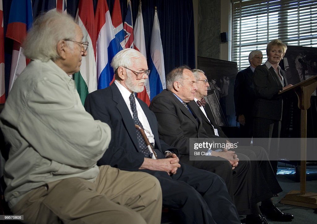 From left, former members of the Monuments, Fine Arts and Archive (MFAA) Lt. Bernard Taper, Sgt. James Reeds, Sgt. Harry Ettinger, and TSgt. Horace Apgar listen as Rep. Kay Granger, R-Texas speaks during the news conference and ceremony in the Russell Senate Office Building on Wednesday June 6, 2007, on the 63rd anniversary of D-Day to honor the Monuments Men, who served during World War II. Robert Edsel, author of 'Rescuing Da Vinci' is seen in the background. The 'Monuments Men' were responsible for the protection and restitution of priceless artistic and cultural treasures in countries occupied by Allied forces in World War II. In 1938, the Nazi party in Germany began a campaign to confiscate millions of pieces of artwork and cultural artifacts throughout Europe.