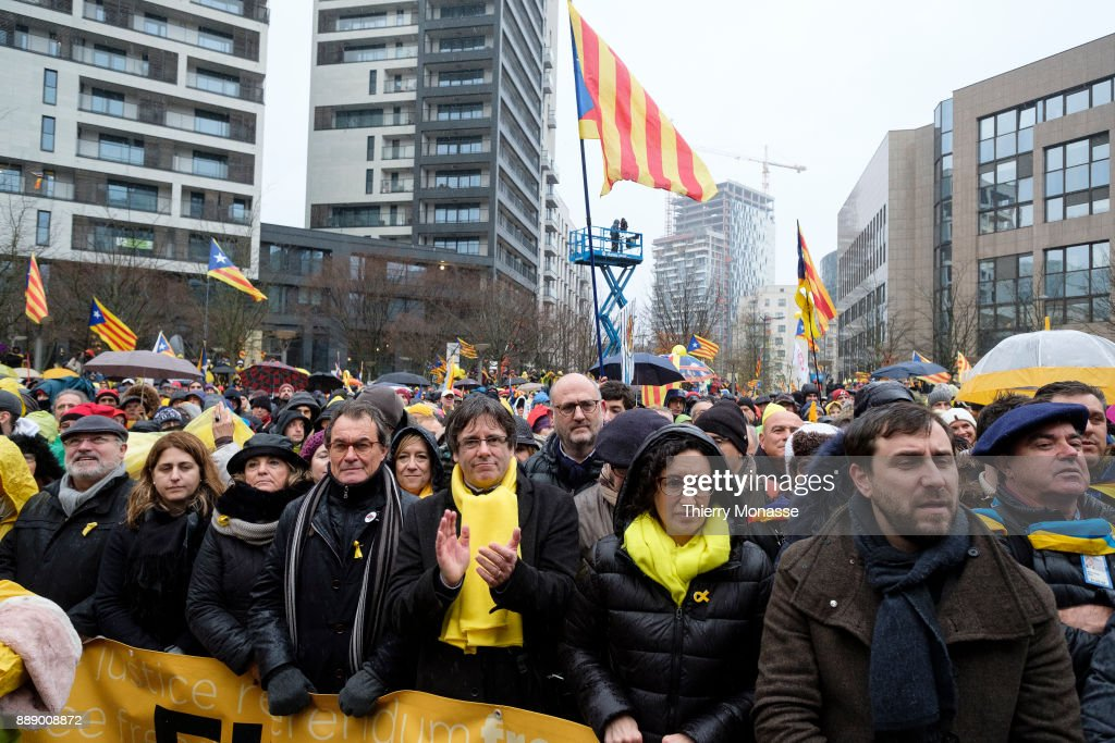 Former President of the Generalitat of Catalonia Artur Mas, Ousted Catalan leader Carles Puigdemont, General Secretary of the Republican Left of Catalonia Marta Rovira Verges and the Dismissed Catalan regional Minister of Health Antoni Comin are listening to speeches during a pro-Catalan supporters during a demonstration in the EU quarter. Thousands of Catalonian people protest for the Independence of Catalonia.