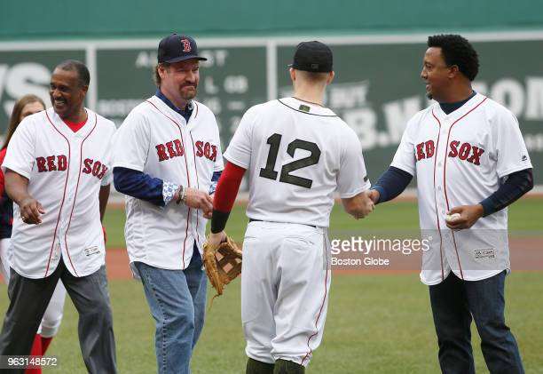 From left former Red Sox players Jim Rice Wade Boggs and Pedro Martinez walk back to the dugout after throwing out the ceremonial first pitch before...