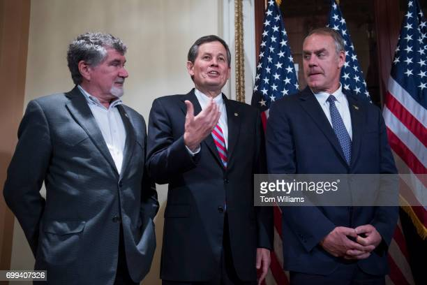 From left former Rep Denny Rehberg RMont Sen Steve Daines RMont and Interior Secretary Ryan Zinke arrive for a swearing in ceremony for Rep Greg...