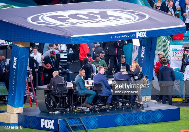 From left FOX Sports analysts Jimmie Johnson Michael Strahan Howie Long Terry Bradshaw and Curt Menefee sit on broadcast stage on the sidelines...
