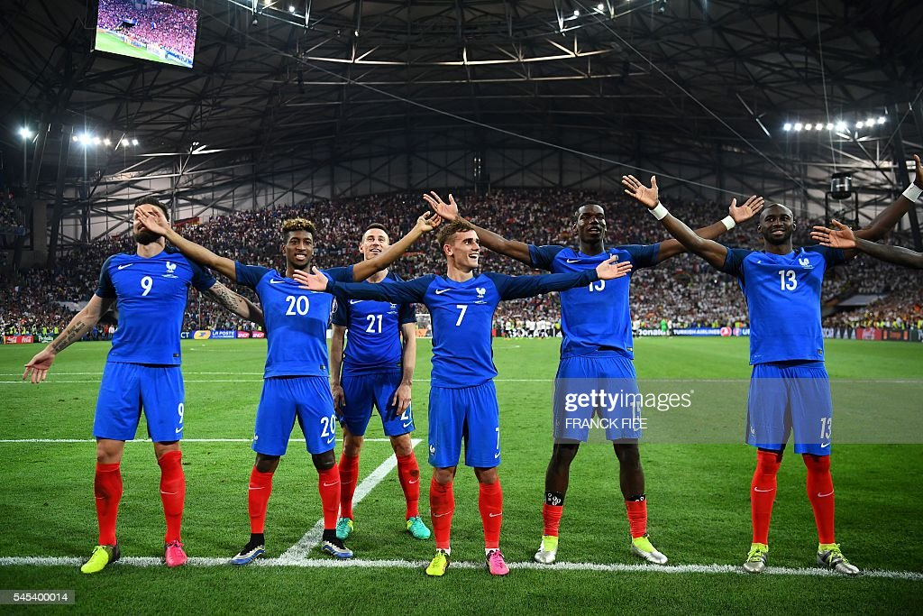 France's forward Olivier Giroud, forward Kingsley Coman, defender Laurent Koscielny, forward Antoine Griezmann, midfielder Paul Pogba, and defender Eliaquim Mangala celebrate after beating Germany 2-0 in the Euro 2016 semi-final football match between Germany and France at the Stade Velodrome in Marseille on July 7, 2016. France will face Portugal in the Euro 2016 finals on July 10, 2016. / AFP / FRANCK