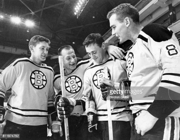 From left Fred Stanfield Eddie Shack Phil Esposito and Ken Hodge talk on the ice after practice at the Boston Garden Oct 2 1967