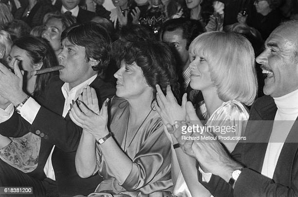 From left, French actor Alain Delon , socialite Regine, actress Mireille Darc, and Scottish actor Sean Connery enjoying the entertainment at the...