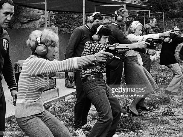 From left French policewomen Simone Kergaravat Elisabeth Abbal and Christine Diebolt are watched over by instructors as they aim handguns at a target...