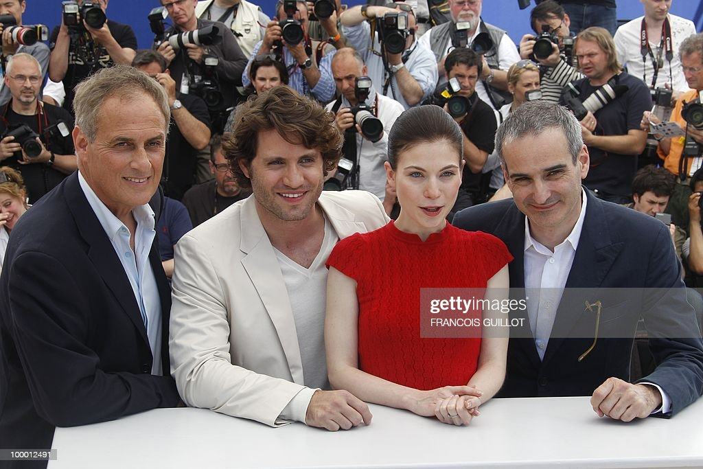 French producer Daniel Leconte, Venezuelian born actor Edgar Ramirez, Austrian actress Nora Von Waldstatten and French director Olivier Assayas pose during the photocall of 'Carlos' presented out of competition at the 63rd Cannes Film Festival on May 20, 2010 in Cannes.