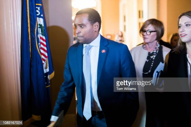 From left freshman members Reps Joe Neguse DColo Susie Lee DNev and Katie Hill DCalif make their way into the Capitol office of Senate Majority...