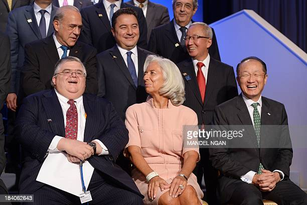 Mexico Central Bank Governor Agustín Carstens laughs with IMF Managing Director Christine Lagarde and World Bank President Jim Yong Kim before the...