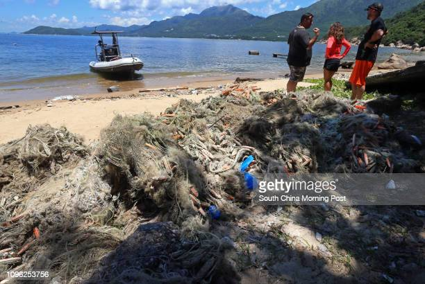 From left Gary Stokes Adrienne Ng and lain Brymer with the nets at Mung Tung Wan near Pui O Lantau 23JUN16 SCMP/ K Y Cheng