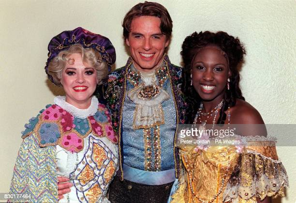 Gemma Craven John Barrowman and singer Michelle Gayle in costume on the first night of a recast 'Beauty and the Beast' musical at the Dominion...
