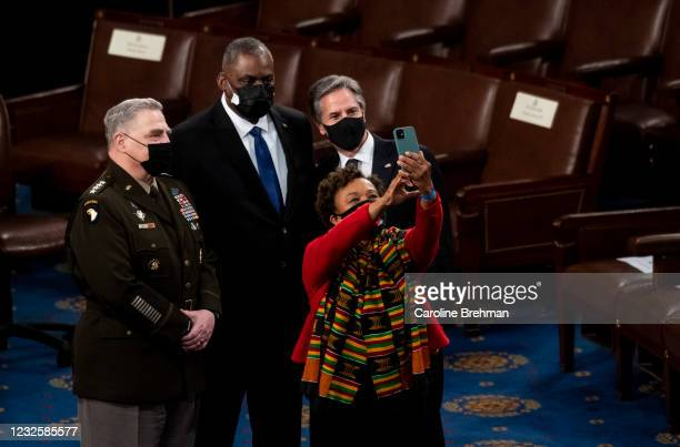 From left, Gen. Mark Milley, Chairman of the Joint Chiefs of Staff, Secretary of Defense Lloyd Austin, Rep. Barbara Lee, D-Calif., and Secretary of...
