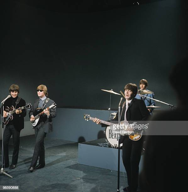From left, George Harrison , John Lennon , Paul McCartney and Ringo Starr of English rock and pop group The Beatles perform together on stage for the...