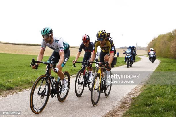 Germany's Max Schachmann , Britain's Tom Pidcock and Belgium's Wout van Aert compete in the Amstel Gold Race in Valkenburg on April 18, 2021. - Wout...