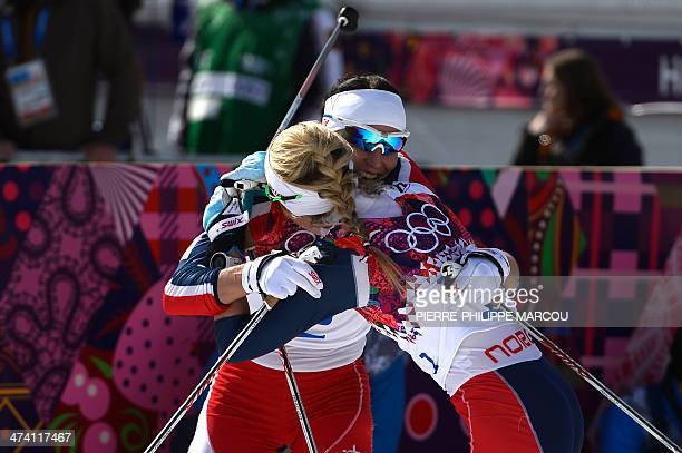 gold medalist Norway's Marit Bjoergen and silver medalist Norway's Therese Johaug celebrate their wins in the Women's CrossCountry Skiing 30km Mass...