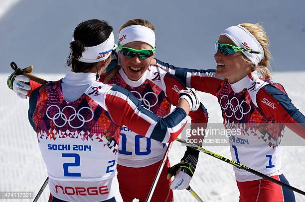Gold medalist Norway's Marit Bjoergen bronze medalist Norway's Kristin Stoermer Steira and silver medalist Norway's Therese Johaug celebrate their...