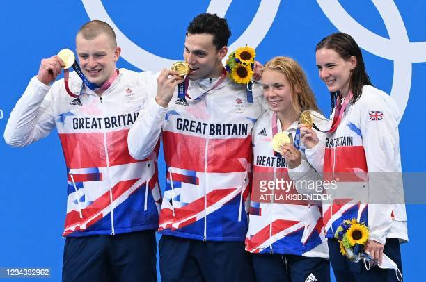 From Left, Gold medallists Britain's Adam Peaty, Britain's James Guy, Britain's Anna Hopkin and Britain's Kathleen Dawson pose with their medals...