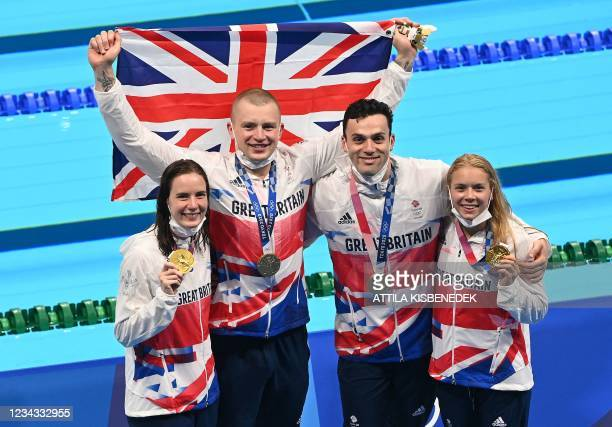 From Left, Gold medallists Britain's Kathleen Dawson, Britain's James Guy, Britain's Adam Peaty, and Britain's Anna Hopkin and pose with their medals...