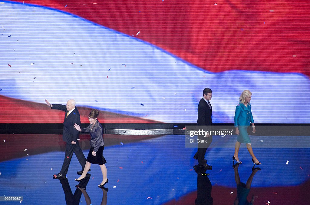 From left, GOP presidential candidate John McCain and GOP vice presidential candidate Sarah Palin, Todd Palin and Cindy McCain wave to the crowd after McCain's speech to the Republican National Convention at the Xcel Center in St. Paul, Minn., on Thursday, Sept. 4, 2008.