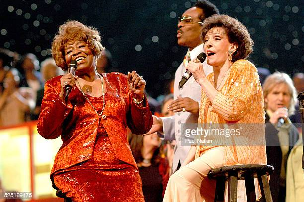 From left gospel musicians Albertina Walker unidentified and Dottie Rambo perform onstage Dallas Texas March 11 2003