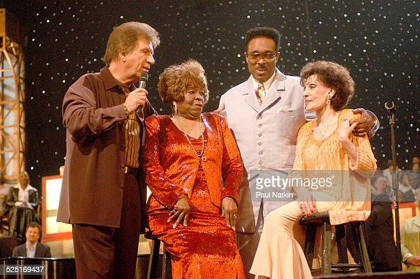 From left gospel musicians Bill Gaither Albertina Walker unidentified and Dottie Rambo perform onstage Dallas Texas March 11 2003