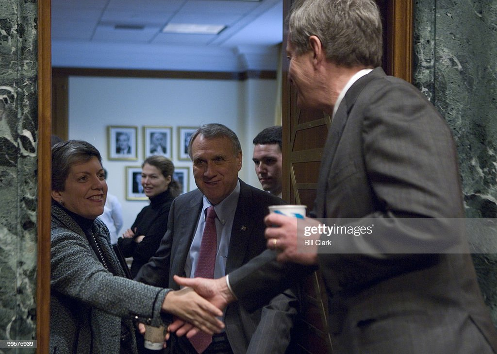 From left, Gov. Janet Napolitano, D-Ariz., greets Sen. Jon Kyl, R-Ariz., and chairman Max Baucus, D-Mont., as she arrives for the Senate Finance Committee hearing on 'Economic and Fiscal Conditions of the States,' on Tuesday, Feb. 26, 2008.