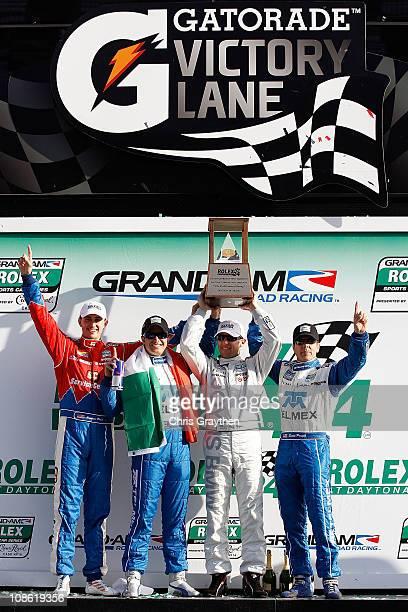 From left Graham Rahal Memo Rojas Joey Hand and Scott Pruett drivers of the TELMEX/Target Chip Ganassi Racing with Felix Sabates BMW Riley celebrate...