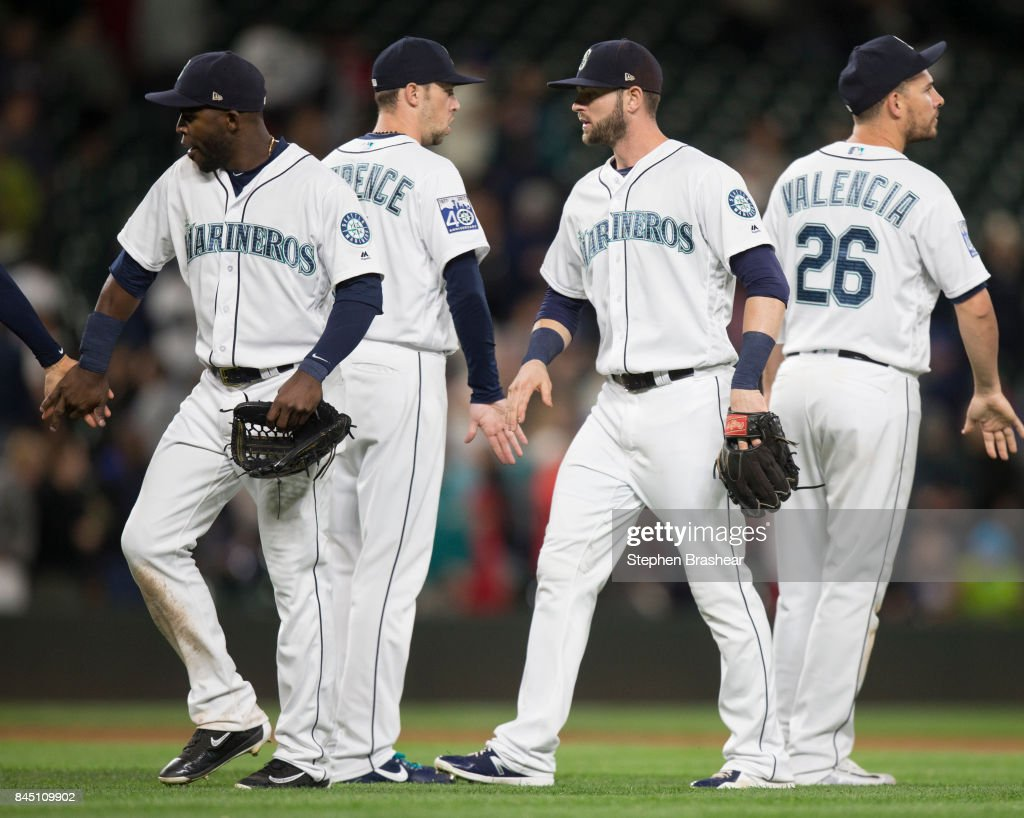 From left, Guillermo Heredia #5 of the Seattle Mariners, Casey Lawrence #61 of the Seattle Mariners, Mitch Haniger #17 of the Seattle Mariners and Danny Valencia #26 of the Seattle Mariners celebrate after a game against the Los Angeles Angels of Anaheim at Safeco Field on September 9, 2017 in Seattle, Washington. The Mariners won the game 8-1.