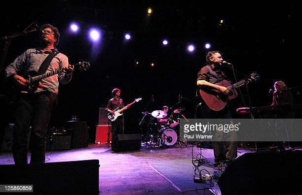 From left guitarist Gary Louris bassist Marc Perlman drummer Tim O'Reagan guitarist Mark Olson and keyboardist Karen Grotberg perform as the Jayhawks...