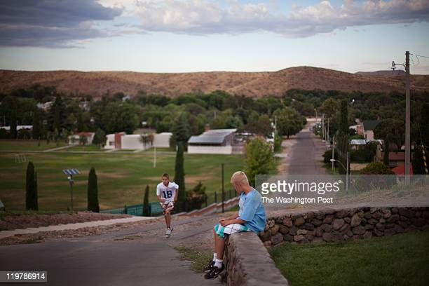 From left Gunner runs up a hill as his brother Cade takes a rest from training in Colonia Juarez Mexico in July 2011 United States Presidential...