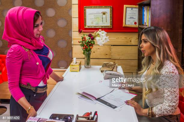 April 20: From left: Hadeel al-Mashhadani, 23-years-old is seen as she talks to Doctor Rafeef al-Yazerie at the Barbie Clinic on April 20, 2015 in...