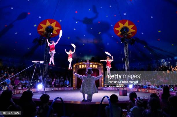 From left Hannah Grove Eva Lou Rhinelander 13 and Ariana Wunderle walk tightropes in high heels during an afternoon performance of Circus Smirkus in...