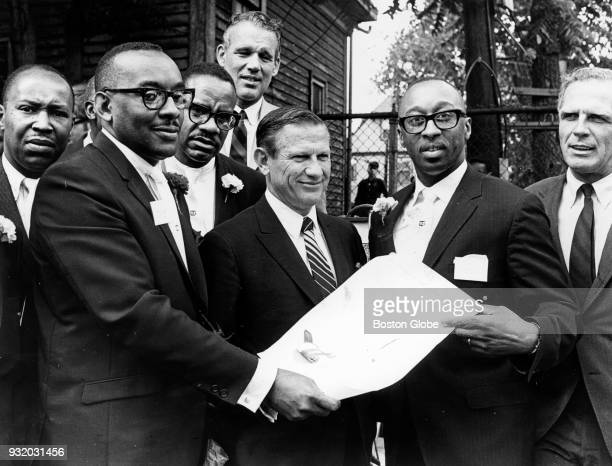From left Harold Vaughan Gov John Volpe Bank President Donald Sneed Jr and Mayor White hold the Unity Bank Trust Co's charter during formal opening...