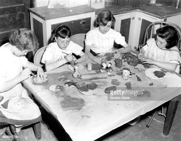From left Helen Dunn Nancy Caster Janice Haley and Maureen Hughes work on ceramics at the Charlestown Girls' Club in Boston on Apr 24 1959