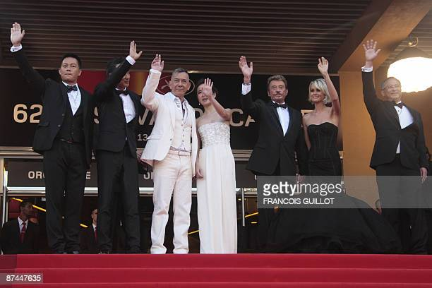 Hong Kong's actors Anthony Wong Simon Yam SiuFai Cheung Michelle Ye French actor and singer Johnny Hallyday and his wife Laeticia arrive for the...