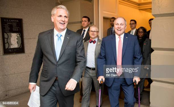 From left House Majority Leader Kevin McCarthy RCalif Chief Deputy Whip Patrick McHenry RNC and House Majority Whip Steve Scalise RLa arrive for the...
