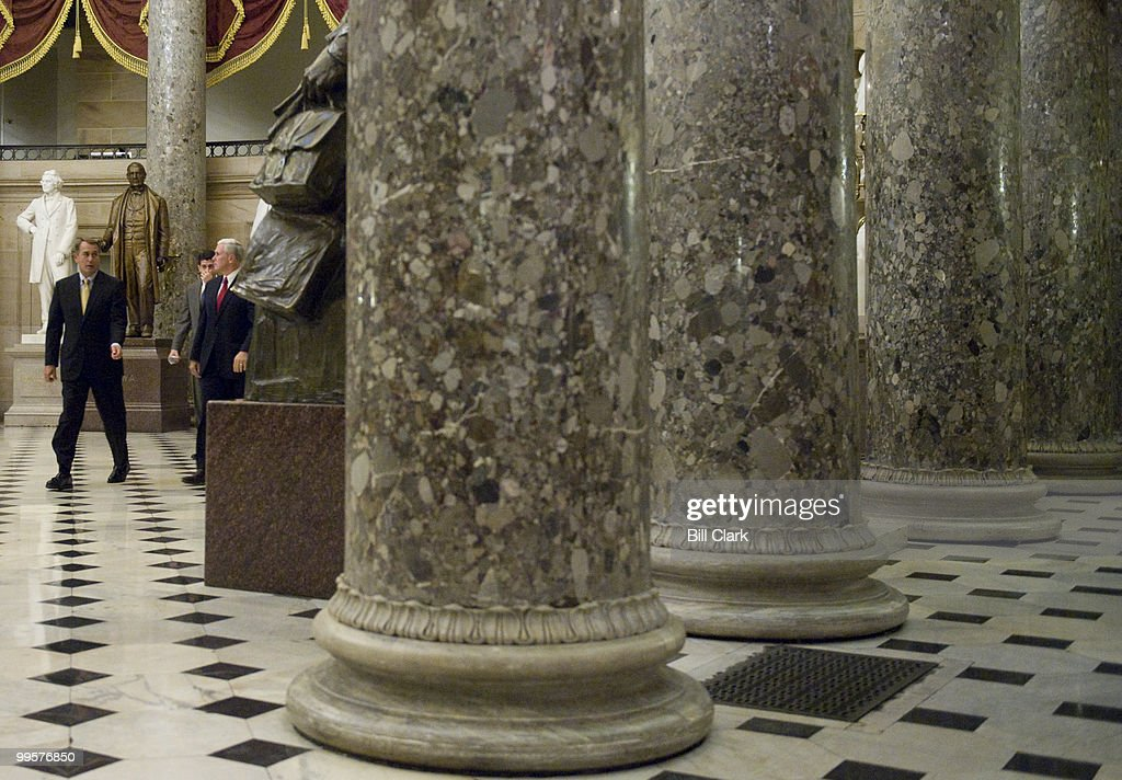 From left, House Minority Leader John Boehner, R-Ohio, Rep. Paul Ryan, R-Wisc., and Rep. Mike Pence, R-Ind., walk through Statuary Hall on their way to hold a news conference with fellow House Republicans on the economic stimulus package in the U.S. Capitol on Wednesday, Jan. 28, 2009.