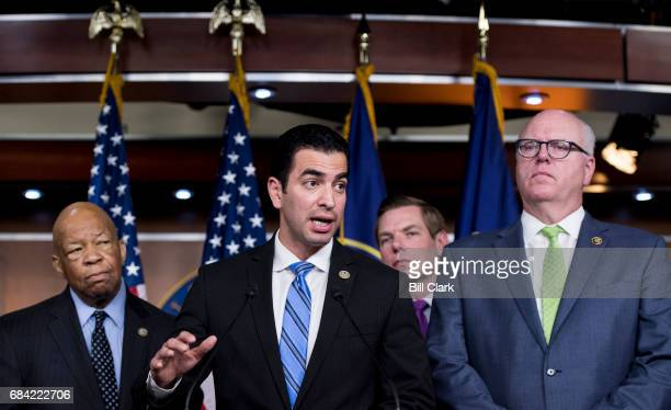 From left House Oversight and Government Reform ranking member Elijah Cummings DMd Rep Ruben Kihuen DNev Rep Eric Swalwell DCalif and chairman of the...