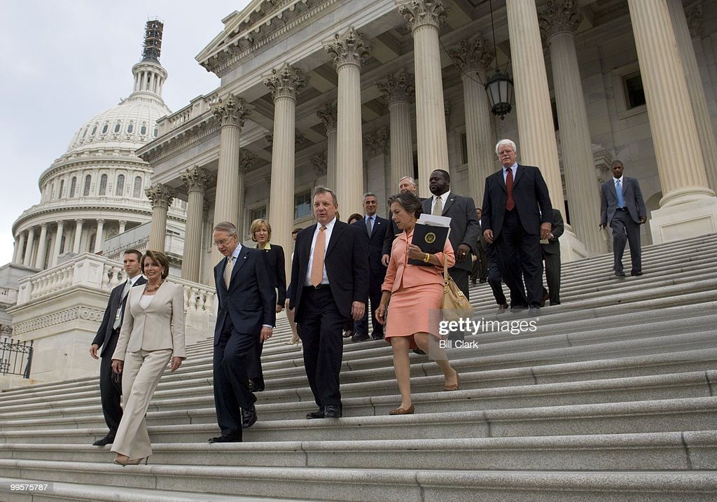 From left, House Speaker Nancy Pelosi, D-Calif., Senate Majority Leader Harry Reid, D-Nev., Senate Assistant Majority Leader Richard Durbin, D-Ill., and Rep. Janice Schakowsky, D-Ill., lead a contigent of Democrats down the east steps of the Senate side of the Capitol on their way to the AFL-CIO Rally celebrating the minimum wage increase in Upper Senate Park on Tuesday, July 24, 2007.
