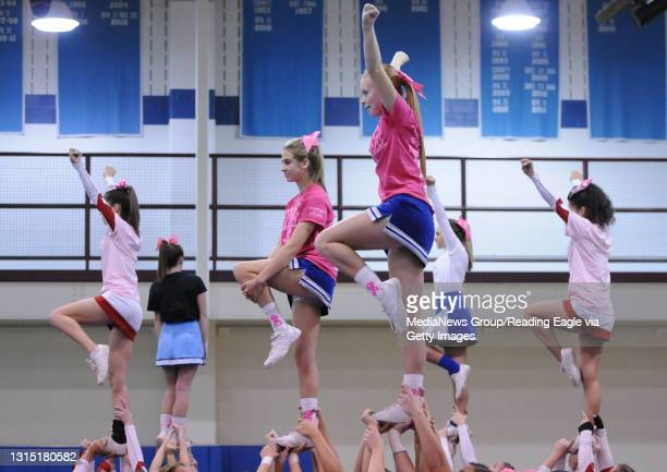 From left in the front center are Lexi Krufka and Jane Stewart both members of the Exeter Varsity cheerleading team. They were competing against...