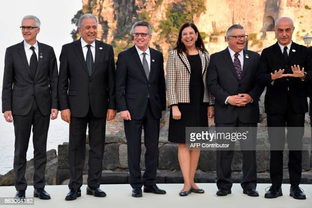 Interpol General secretary Jurgen Stock EU Commissioner for Migration Home Affairs and Citizenship Dimitris Avramopoulos Germany's Interior Minister...